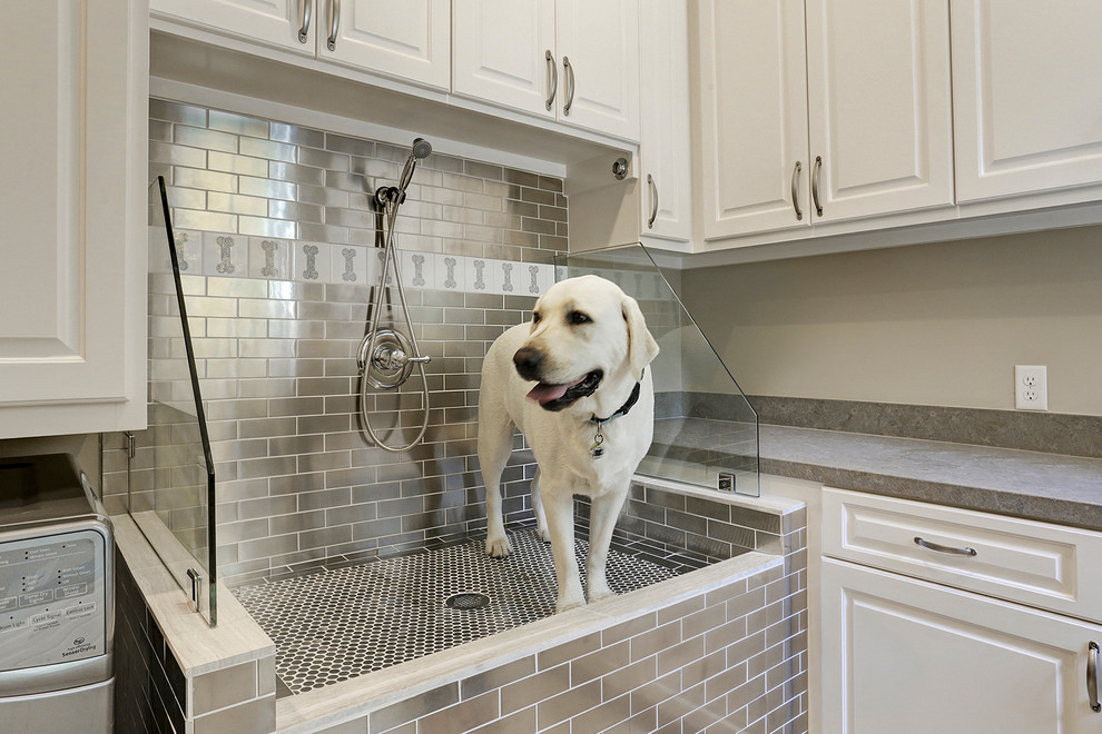 Inspiration for a timeless utility room remodel in Houston with raised-panel cabinets and white cabinets