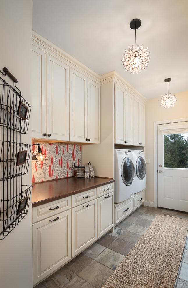 Inspiration for a cottage gray floor laundry room remodel in Cincinnati with beige cabinets, beige walls, a side-by-side washer/dryer, wood countertops, brown countertops and raised-panel cabinets