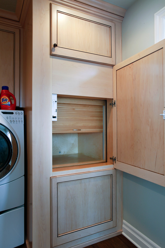 Example of a beach style laundry room design in Portland