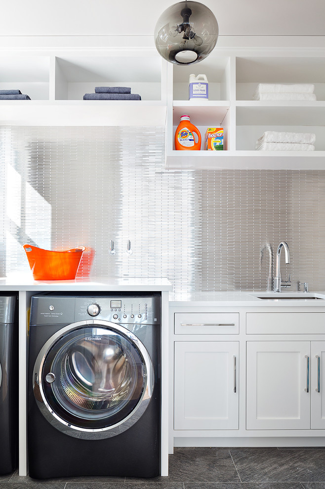 Transitional laundry room photo in New York with white cabinets, a side-by-side washer/dryer, an undermount sink and shaker cabinets