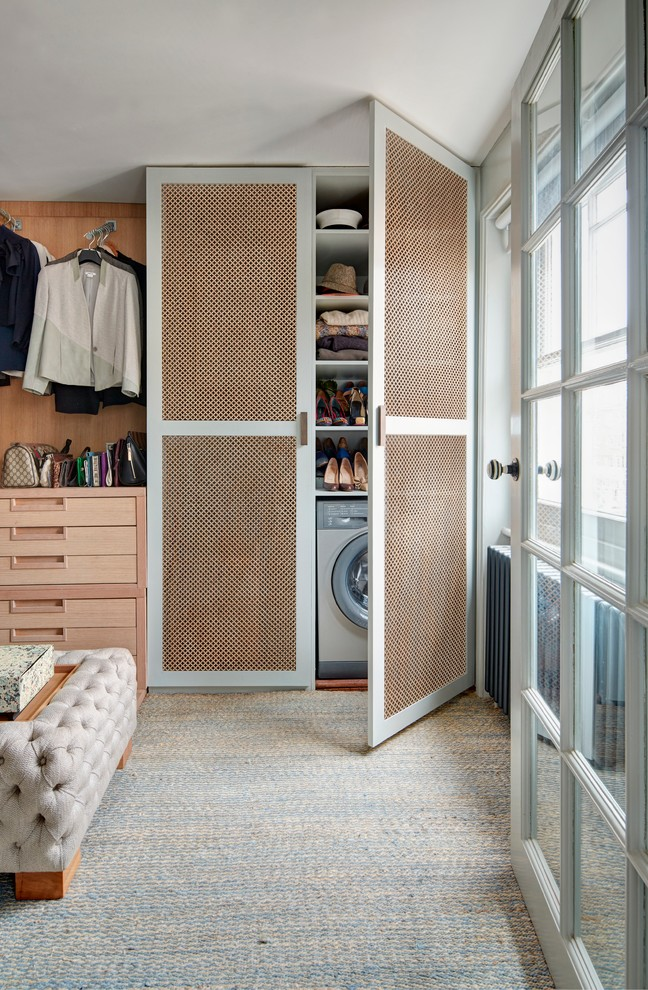 Transitional laundry closet photo in London