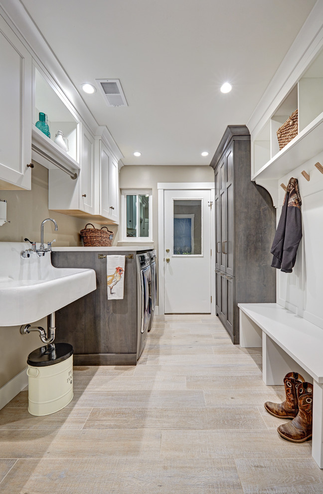Utility room - mid-sized farmhouse galley porcelain tile utility room idea in Sacramento with a farmhouse sink, recessed-panel cabinets, white cabinets, quartz countertops, beige walls and a side-by-side washer/dryer