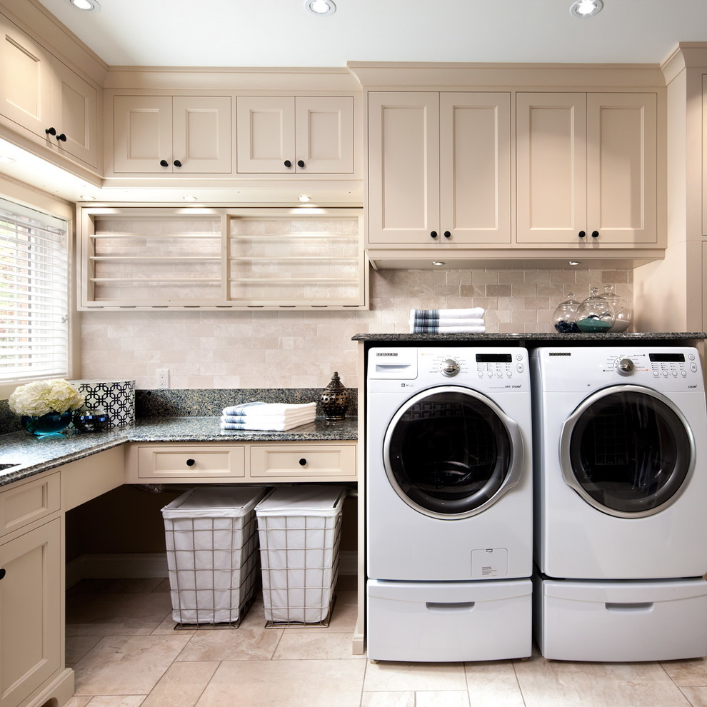 Example of a classic l-shaped utility room design in Toronto with recessed-panel cabinets, beige cabinets, a side-by-side washer/dryer and black countertops