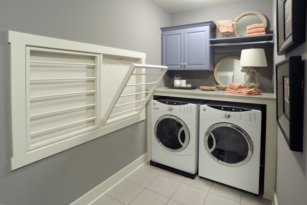 Inspiration for a timeless laundry room remodel in Columbus with gray walls and gray countertops