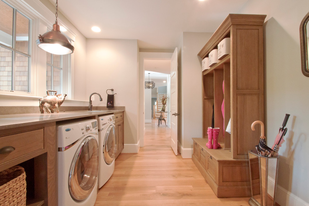 Example of a classic laundry room design in DC Metro with beige walls and beige countertops