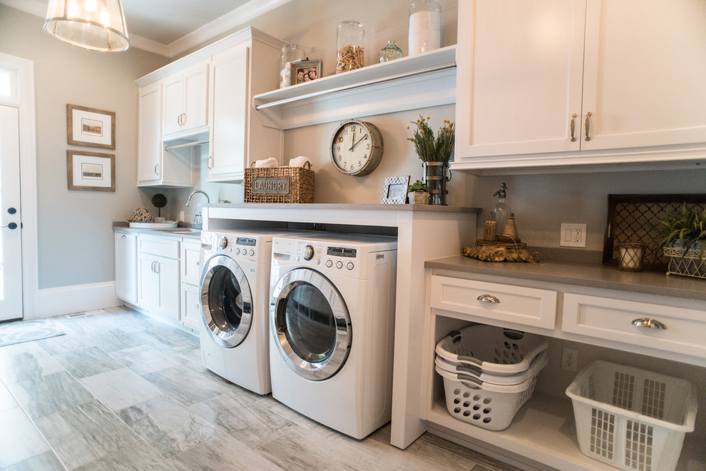 Farmhouse single-wall dedicated laundry room photo in Atlanta with an undermount sink, recessed-panel cabinets, white cabinets, a side-by-side washer/dryer and gray countertops