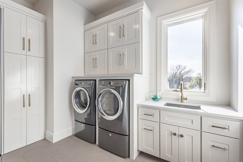 Laundry room - transitional laundry room idea in Oklahoma City with an undermount sink, shaker cabinets, white cabinets, white walls and a side-by-side washer/dryer