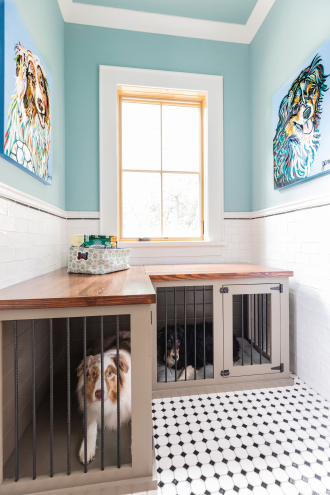 Dedicated laundry room - large country l-shaped ceramic tile and multicolored floor dedicated laundry room idea in Houston with an undermount sink, shaker cabinets, black cabinets, granite countertops, blue walls, a side-by-side washer/dryer and black countertops