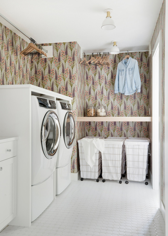 Dedicated laundry room - farmhouse white floor dedicated laundry room idea in Minneapolis with shaker cabinets, white cabinets, multicolored walls, a side-by-side washer/dryer and white countertops
