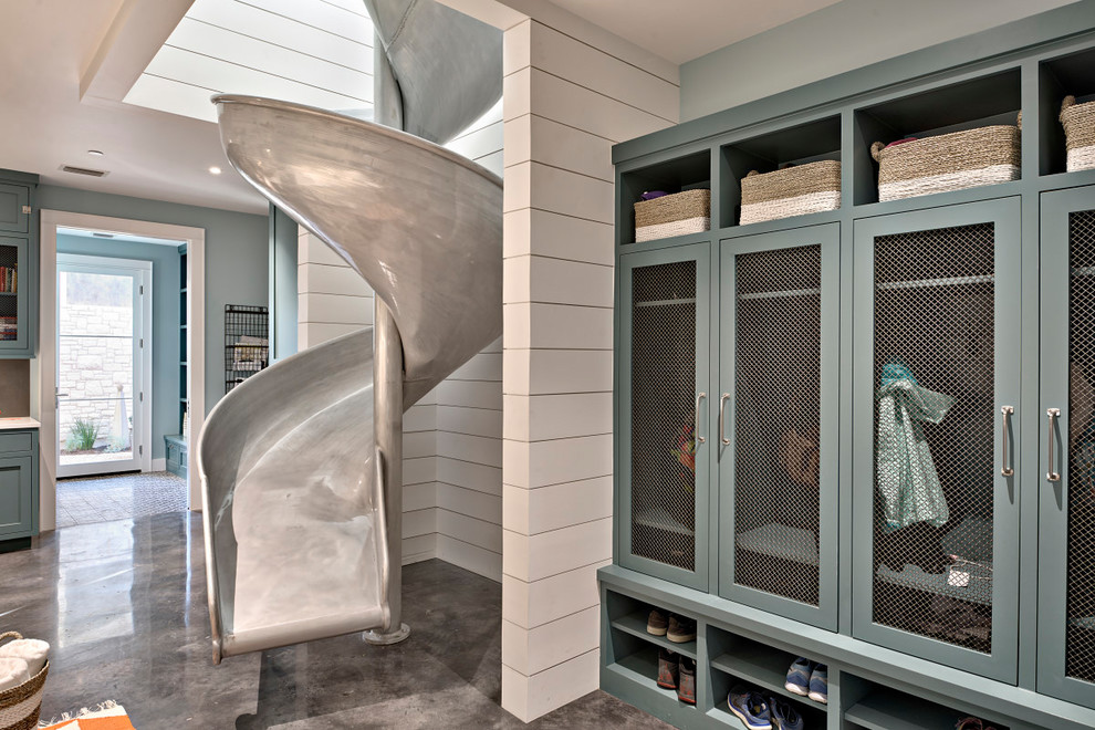 Inspiration for a huge country galley concrete floor utility room remodel in Austin with blue cabinets, quartz countertops, blue walls, a side-by-side washer/dryer and shaker cabinets