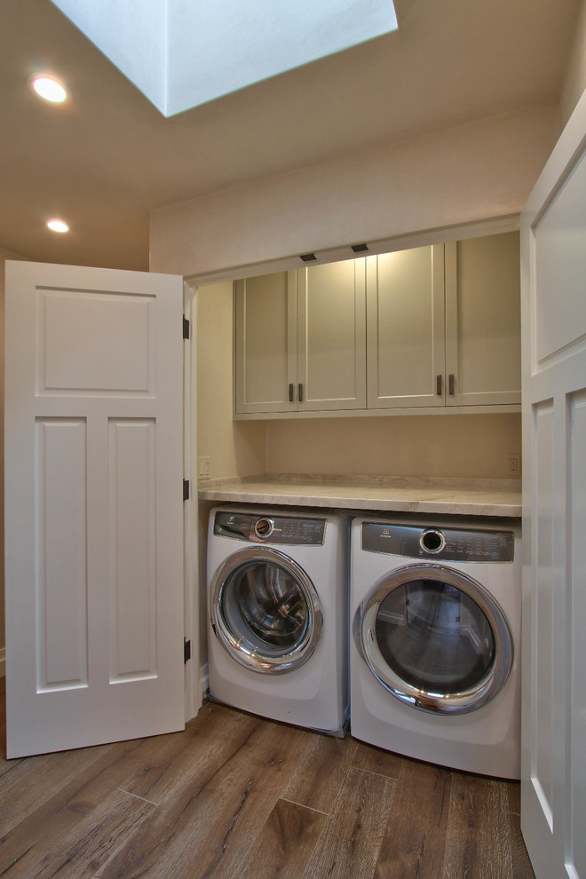 Transitional laundry room photo in Other