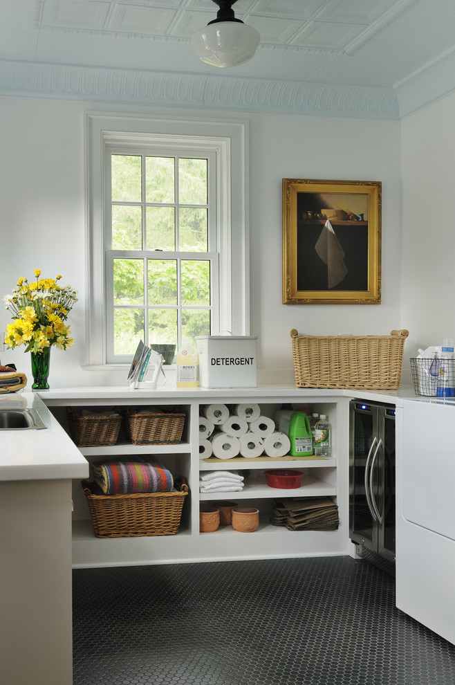 Inspiration for a timeless black floor laundry room remodel in New York with open cabinets, white cabinets, white walls and white countertops