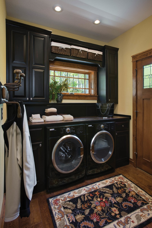 how to remodel your laundry room Installing Cabinets in Laundry Room