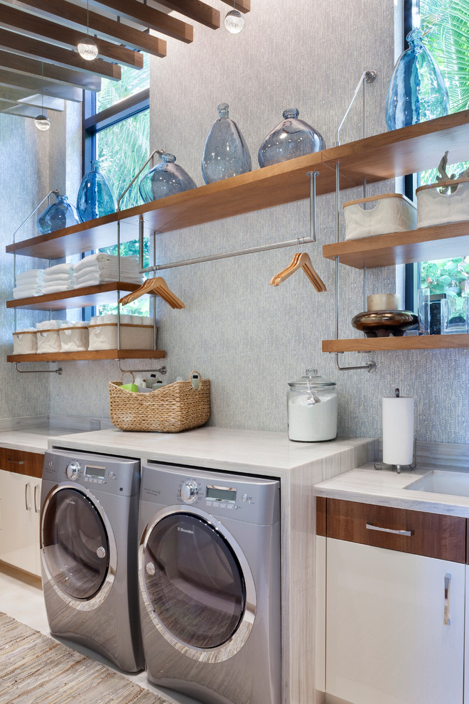 Trendy dedicated laundry room photo in Miami with open cabinets and medium tone wood cabinets