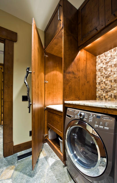 Rustic Laundry Room by Sticks and Stones Design Group Inc