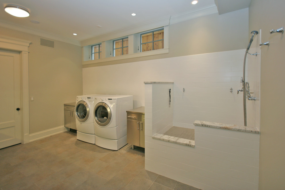 Example of a large classic single-wall ceramic floor utility room design in Chicago with flat-panel cabinets, gray cabinets, stainless steel countertops and gray walls