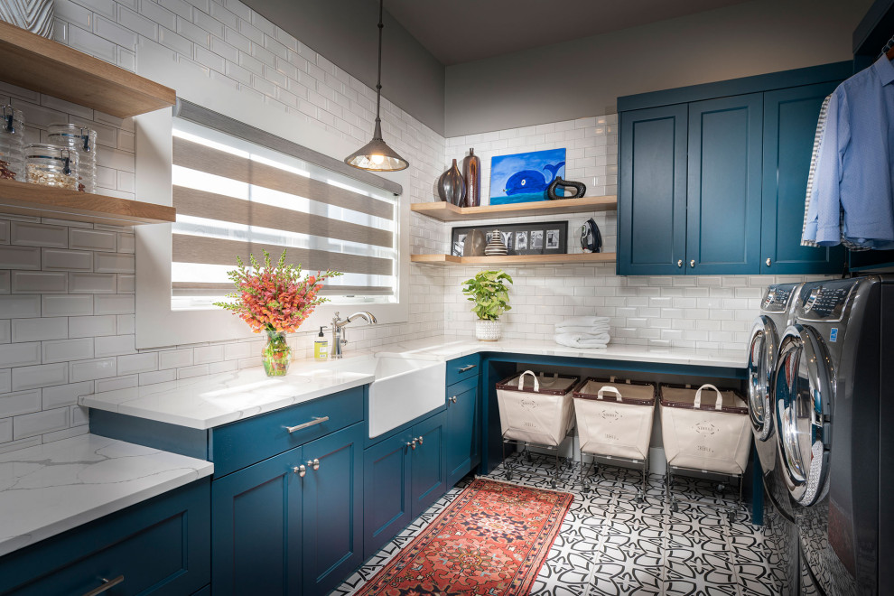 Utility room - large transitional u-shaped ceramic tile and white floor utility room idea in Other with an undermount sink, blue cabinets, quartz countertops, a side-by-side washer/dryer, white countertops, recessed-panel cabinets and gray walls