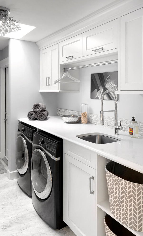 Laundry room - traditional laundry room idea in Vancouver with an undermount sink, recessed-panel cabinets, white cabinets, white walls, a side-by-side washer/dryer and white countertops