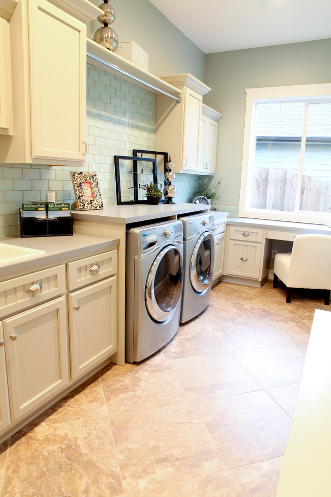 Laundry room - traditional laundry room idea in Seattle with white cabinets