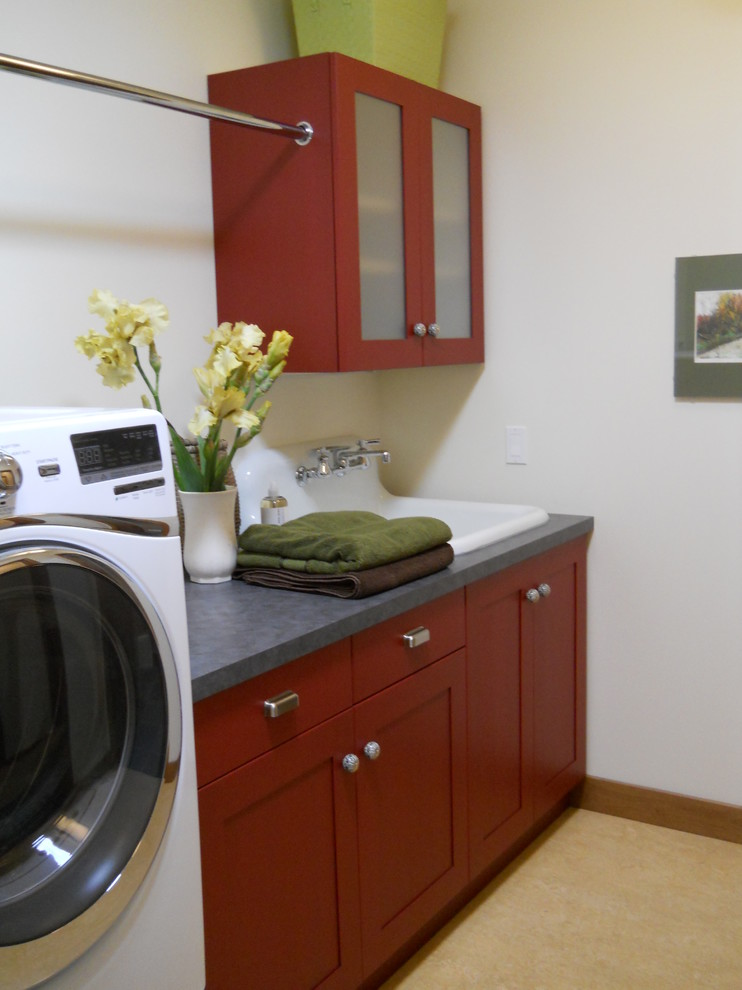 Inspiration for a country laundry room remodel in Other