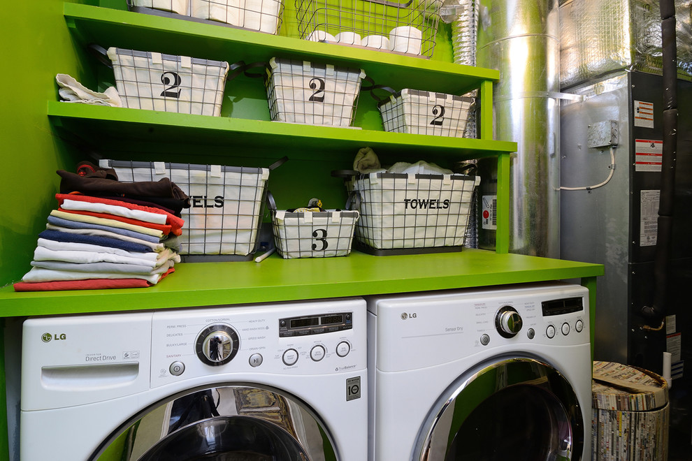 Inspiration for an eclectic laundry room remodel in New York with open cabinets, green cabinets, green walls and green countertops
