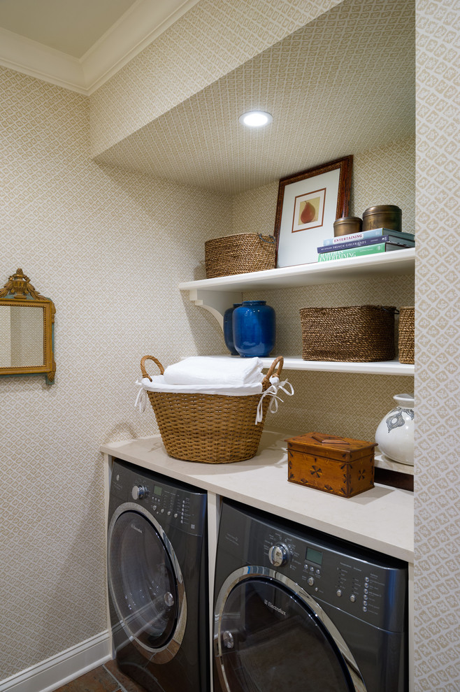 Laundry room - small transitional porcelain tile laundry room idea in New York with quartz countertops, beige walls and a side-by-side washer/dryer
