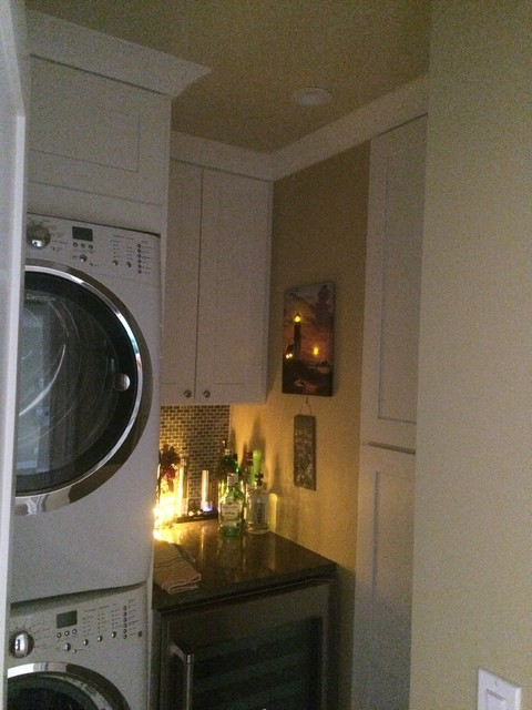 Laundry room - transitional laundry room idea in Other
