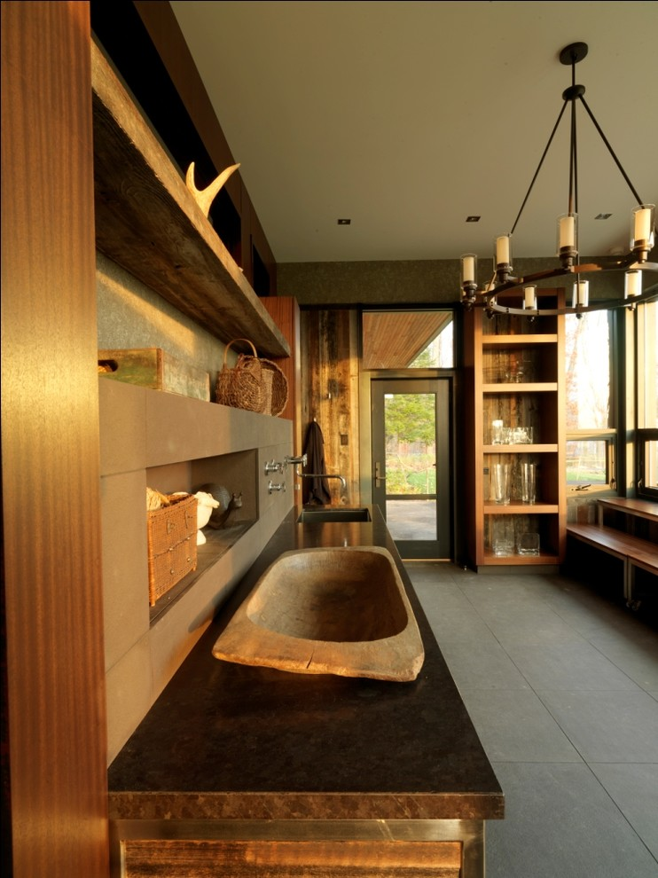 Laundry room - rustic laundry room idea in Burlington with an undermount sink