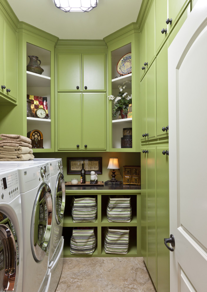 Inspiration for a timeless beige floor laundry room remodel in Little Rock with green cabinets