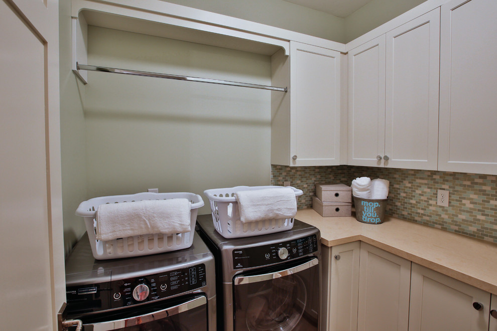 Inspiration for a large transitional galley dedicated laundry room remodel in Salt Lake City with an undermount sink, shaker cabinets, white cabinets, beige walls, a side-by-side washer/dryer and quartzite countertops