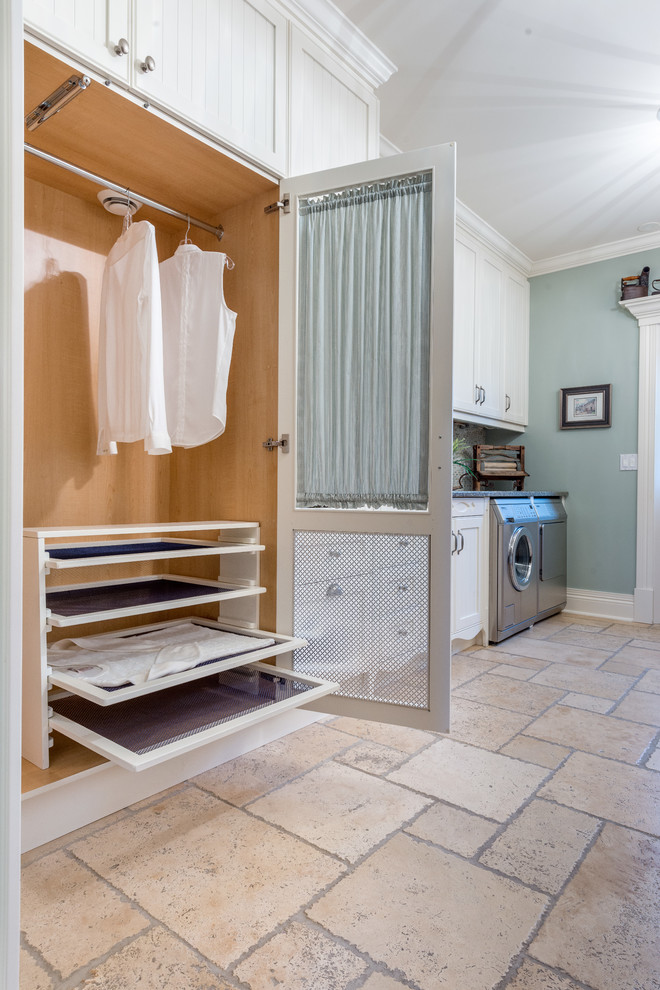 Mid-sized transitional single-wall limestone floor and beige floor dedicated laundry room photo in Ottawa with shaker cabinets, white cabinets and blue walls