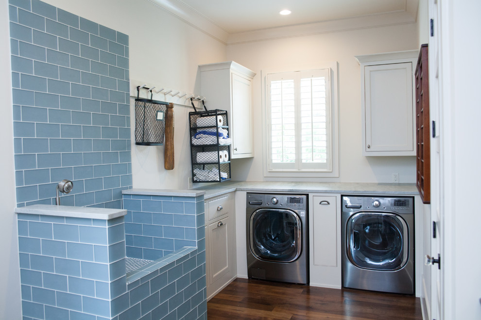 Utility room - farmhouse l-shaped dark wood floor utility room idea in Atlanta with white walls and a side-by-side washer/dryer