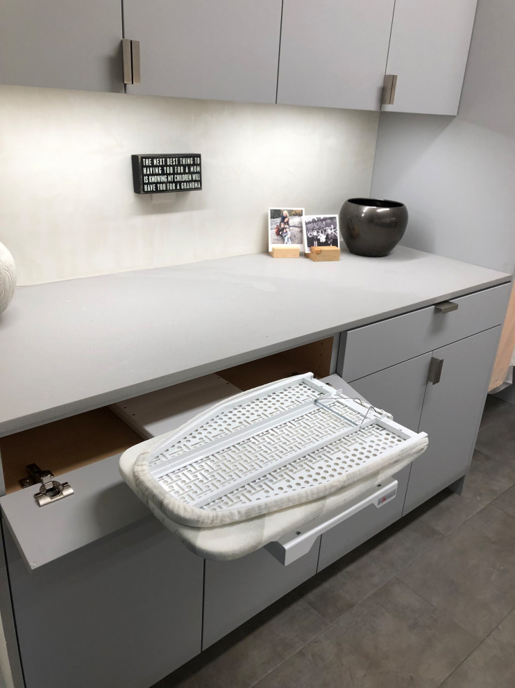 Dedicated laundry room - mid-sized contemporary galley gray floor dedicated laundry room idea in Other with an undermount sink, flat-panel cabinets, gray cabinets, beige walls, a side-by-side washer/dryer and gray countertops
