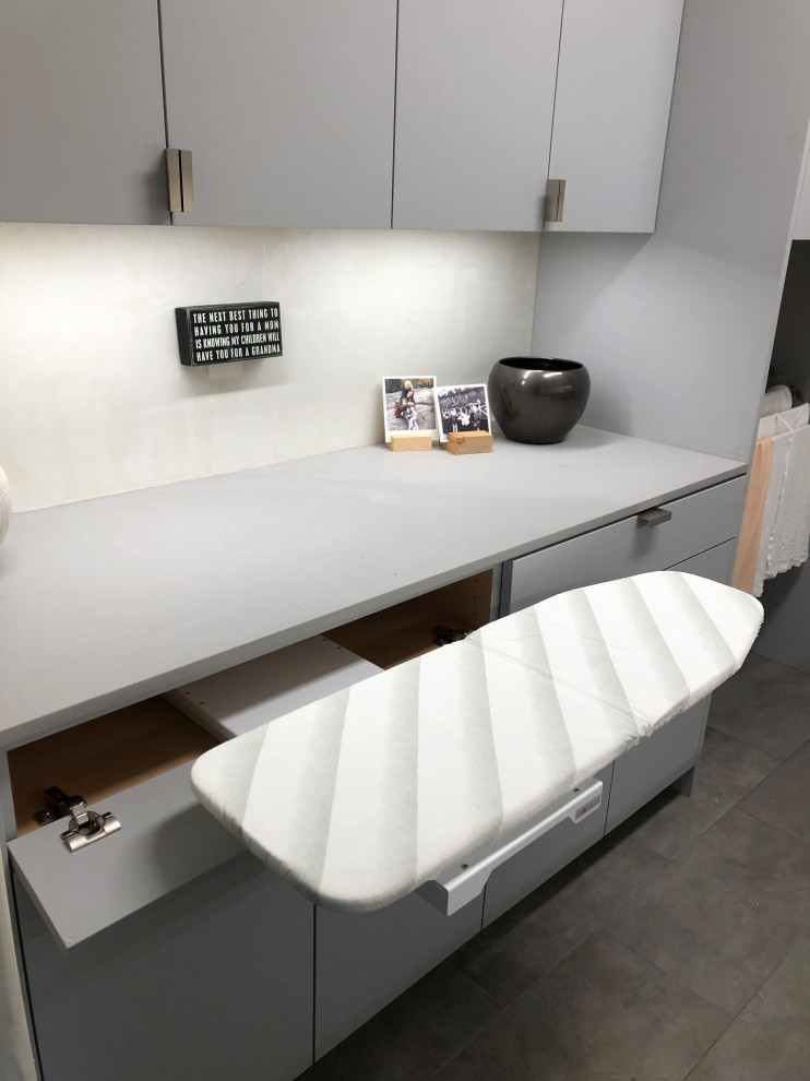 Inspiration for a mid-sized contemporary galley gray floor dedicated laundry room remodel in Other with an undermount sink, flat-panel cabinets, gray cabinets, beige walls, a side-by-side washer/dryer and gray countertops
