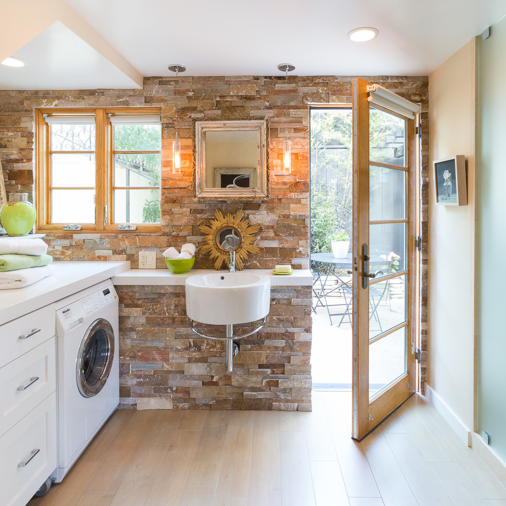 Utility room - transitional l-shaped light wood floor utility room idea in San Francisco with a single-bowl sink, recessed-panel cabinets, white cabinets, beige walls and a side-by-side washer/dryer