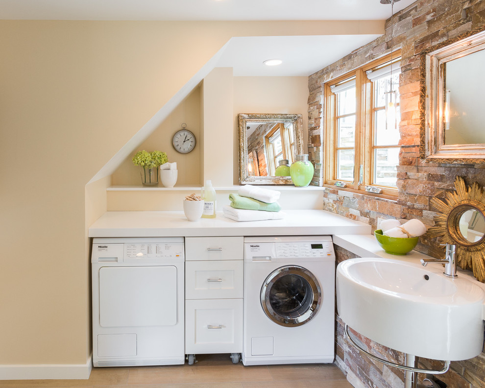 Example of a transitional l-shaped light wood floor utility room design in San Francisco with a single-bowl sink, recessed-panel cabinets, white cabinets, beige walls and a side-by-side washer/dryer