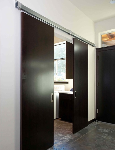 sliding doors to laundry modern laundry room seattle by dan nelson designs northwest. Black Bedroom Furniture Sets. Home Design Ideas