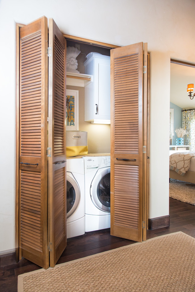 Inspiration for a small transitional dark wood floor laundry closet remodel in Other with beige walls and a side-by-side washer/dryer