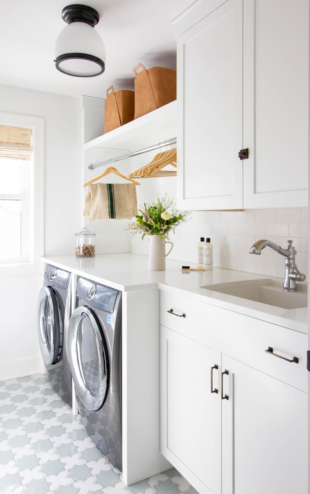 Dedicated laundry room - mid-sized transitional single-wall ceramic tile and multicolored floor dedicated laundry room idea in Minneapolis with white cabinets, quartz countertops, white walls, a side-by-side washer/dryer, white countertops, an undermount sink and shaker cabinets