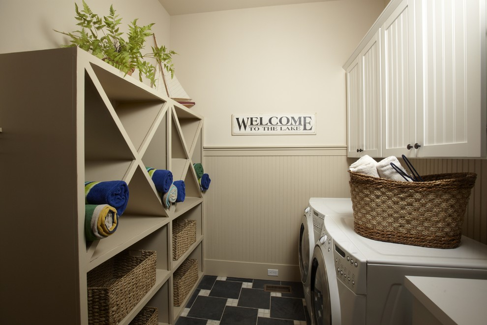 Example of a classic laundry room design in Tampa with beige walls