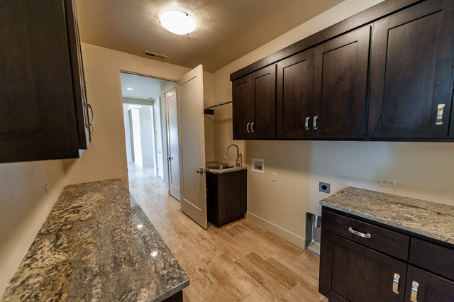 Example of a trendy laundry room design in Other
