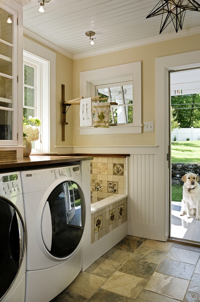 Laundry room - traditional laundry room idea in Burlington with brown countertops and beige walls