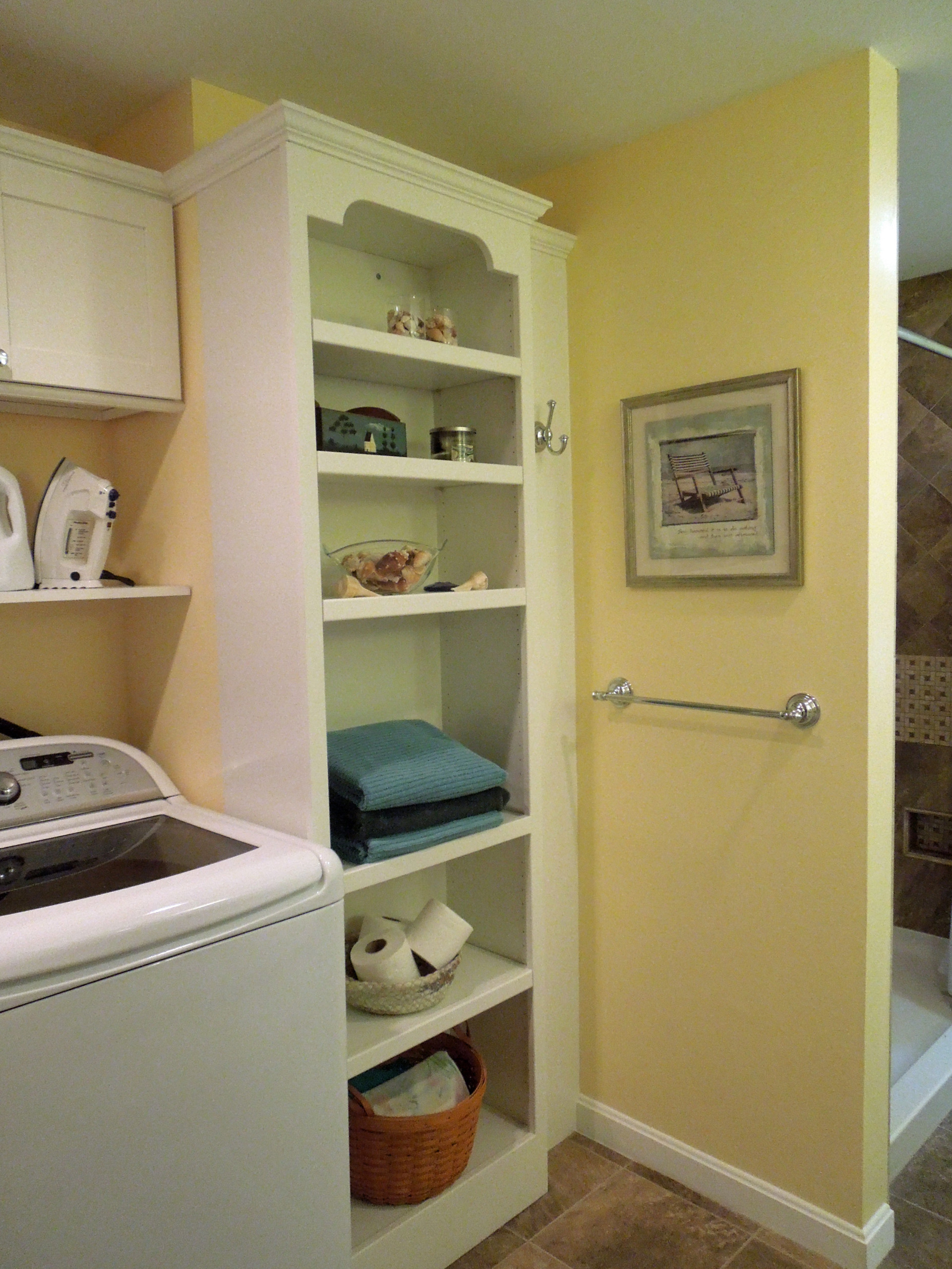 Sunny storage for a luxe laundry room and bath.