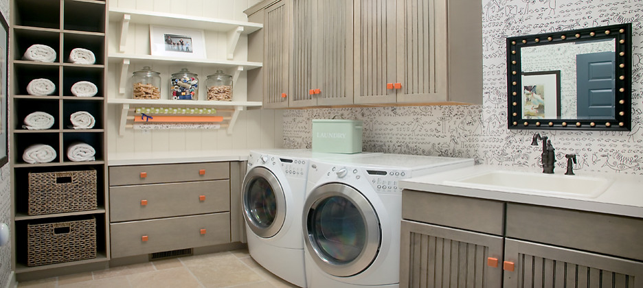 Inspiration for a large transitional l-shaped slate floor utility room remodel in Grand Rapids with a drop-in sink, a side-by-side washer/dryer and gray cabinets