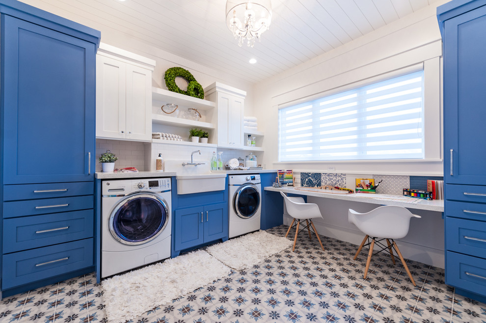 Inspiration for a mid-sized transitional ceramic tile and multicolored floor utility room remodel in Salt Lake City with a farmhouse sink, shaker cabinets, blue cabinets, quartz countertops, a side-by-side washer/dryer and white walls