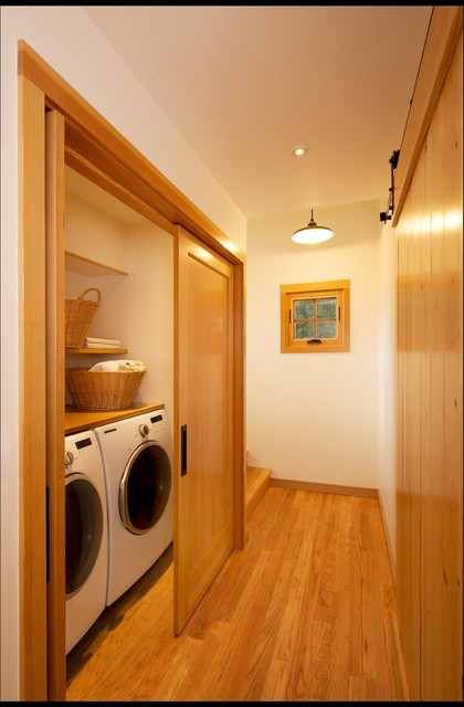 The Laundry: Tucked Away Behind Fir Doors With Flipper Door Hardware.  Industrial Laundry