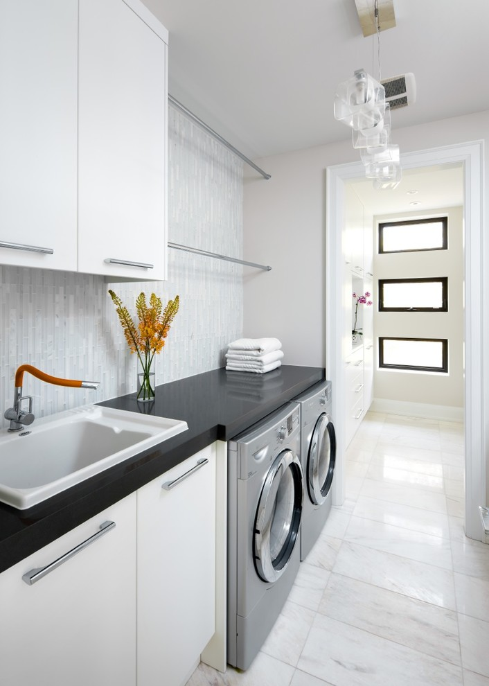 Inspiration for a transitional laundry room remodel in Toronto with white cabinets and black countertops