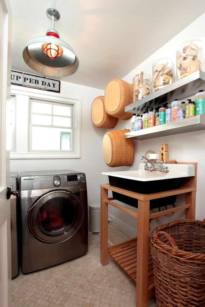 Inspiration for an eclectic dedicated laundry room remodel in Los Angeles with a drop-in sink and a side-by-side washer/dryer