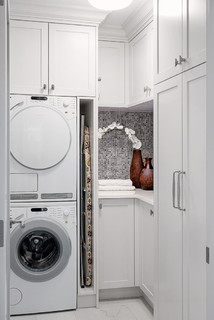 Laundry room - ironing board storage