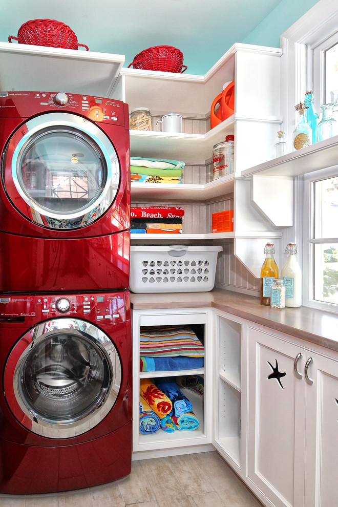 Inspiration for a timeless laundry room remodel in Philadelphia with a stacked washer/dryer